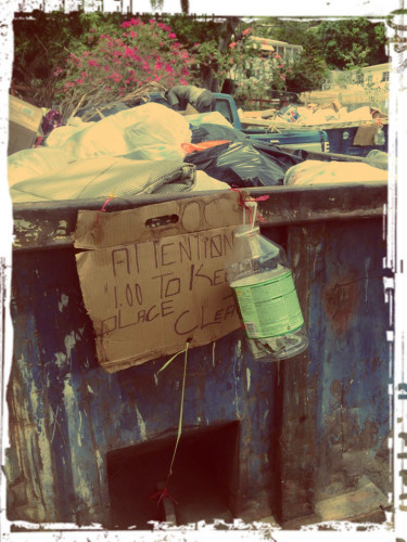 "dumpster donation jar with sign: ""Attention $1 to keep clean"""